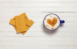 Cup of coffee with heart shape symbol and waffles Stock Photos