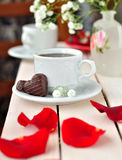 A Cup of Coffee with Heart-Shaped Candies Royalty Free Stock Photography