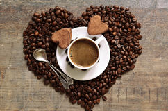 Cup of coffee with heart-shaped chocolate truffles. Stock Photo
