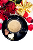 Cup of coffee with heart shaped chocolates, valentines day stock photo