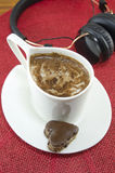 Cup of coffee and a heart shaped cookie Stock Photography