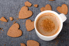 Cup of coffee and heart shaped cookies. Stock Photos