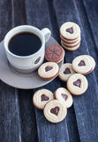 Cup of coffee and heart shaped cut out cookies Royalty Free Stock Images