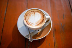 Cup of coffee. With heart-shaped decoration on a wooden table Stock Photo