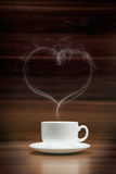 Cup of coffee with heart-shaped smoke Royalty Free Stock Images