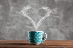 Cup of coffee with a heart shaped steam royalty free stock photos