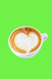 Cup of coffee with heart symbol isolated on green background Stock Photo