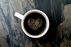Cup coffee with heart symbol Royalty Free Stock Photo