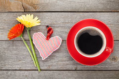 Cup of coffee, heart toy and gerbera flowers Stock Photography