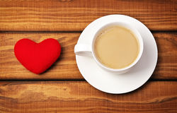 Cup of coffee and heart Stock Photos