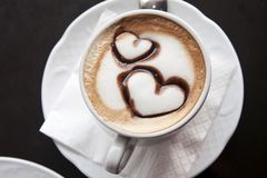 Cup of coffee with hearts. A cup of espresso coffee with hearts Royalty Free Stock Photo