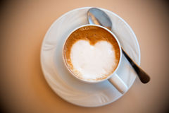 Cup of coffee with heartshaped milk Stock Images