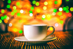 Cup of coffee  in   holiday colorful bokeh background Stock Images