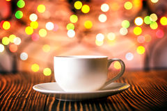 Cup of coffee  in   holiday colorful bokeh background Royalty Free Stock Photography
