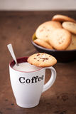 Cup of coffee with a homemade cookie Royalty Free Stock Photos