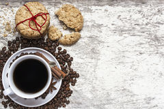Cup of coffee and homemade cookies tied with red ribbon Royalty Free Stock Photos