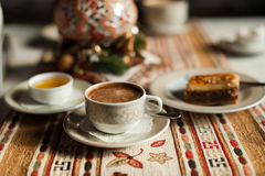 A cup of coffee with honey and baklava Royalty Free Stock Images