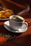 Cup of coffee. Hot cup of coffee with biscuits Stock Photos