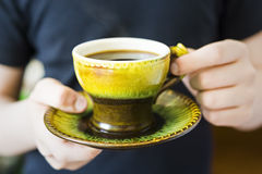 Cup of coffee in human hands Stock Image