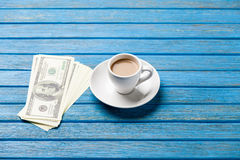 Cup of coffee and hundred dollars Stock Photography