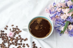 Cup of coffee and hyacinth flowers Royalty Free Stock Photography