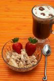 Cup of coffee with ice-cream. Cup of creamy coffee (Caffe Borgia) with ice-cream and strawberries in a bowl Stock Photos