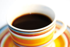 Cup of coffee II. Multicolor cup of coffee in the morning light stock image