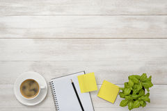 Cup of coffee, indoor plant, empty notebook with pencil and stickers. Royalty Free Stock Photos