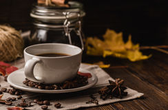 Cup of coffee with ingredients, spices and some kitchenware. Stock Image