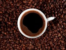Cup of coffee isolated on roasted coffee beans Stock Photos