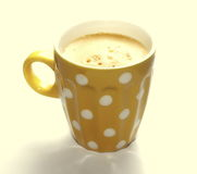 Cup of coffee isolated on yellow Stock Images