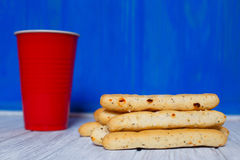 Cup of coffee and italian bread sticks grissini on wooden table Royalty Free Stock Photography