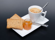 A cup of coffee with jam and  and rusks Stock Photos