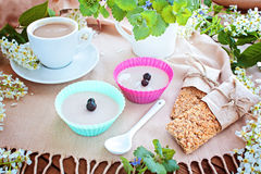 Cup of coffee, jelly, grain small loafs on a table Royalty Free Stock Photography