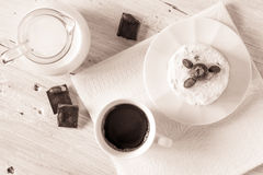 Cup of coffee with jug of milk cake and chocolate on the white table top view. Cup of coffee with jug of milk , cake  and chocolate on the white wooden table top Royalty Free Stock Images
