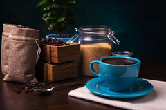 cup of coffee and jute bags, wooden container, cane sugar Stock Photo