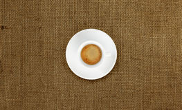 Cup of coffee on jute fabric Royalty Free Stock Images