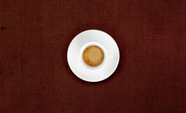 Cup of coffee on jute fabric Stock Photo