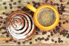 A cup of coffee with kanelbulle. royalty free stock images