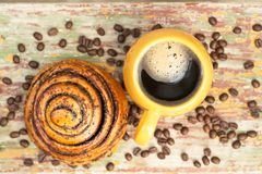 A cup of coffee with kanelbulle. stock photos