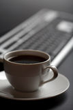 Cup of coffee and keyboard. Cup of black coffee and keyboard Royalty Free Stock Photos