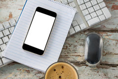 Cup of coffee with keyboard, mobile phone and mouse Royalty Free Stock Photography