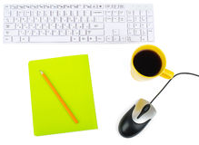 Cup of coffee with keyboard and mouse Stock Images