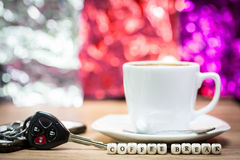 Cup of coffee with keys, Coffee break concept Royalty Free Stock Photography
