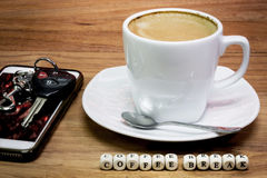 Cup of coffee with keys, Coffee break concept Royalty Free Stock Photos