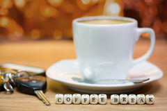 Cup of coffee with keys, Coffee break concept Stock Images