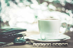 Cup of coffee with keys, Coffee break concept Stock Image