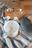 A cup of coffee on a kitchen towel Royalty Free Stock Photos