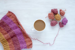 Cup of coffee and knitting on white background Royalty Free Stock Photography