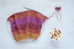 Cup of coffee and knitting on white background Royalty Free Stock Photos